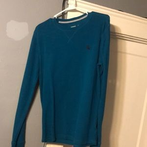 Selling a blue express sweater.
